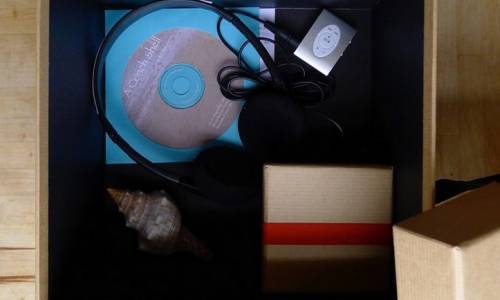 A conch shell and earphones in a box